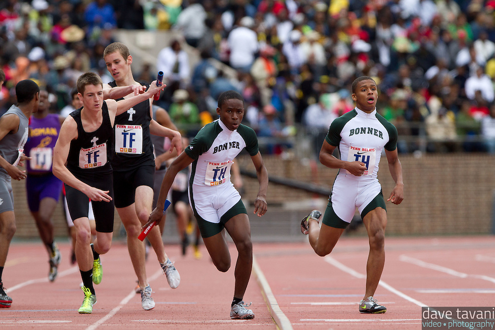 Brian Hamilton hands off to Kenny McAndress for Cardinal O'Hara in the High School Boys' 4x400 Philadelphia Catholic Saturday at the Penn Relays. McAndress ran a split of 50.24, and O'Hara won the event in 3:20.92 ahead of Monsignor Bonner and West Catholic.