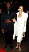 """Djimon Hounsou arrives with Victoria Mahoney at the Warner Theatre for the Washington, D.C. Premiere of his latest movie """"Amistad"""" on December 4, 1997..Credit: Ron Sachs / CNP"""