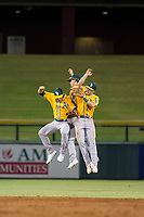 AZL Athletics outfielders Adrian Spitz (4), Austin Beck (38), and Ben Spitznagel (18) celebrate after a victory against the AZL Cubs on August 9, 2017 at Sloan Park in Mesa, Arizona. AZL Athletics defeated the AZL Cubs 7-2. (Zachary Lucy/Four Seam Images)