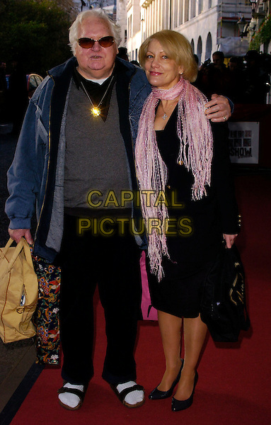 KEN RUSSELL & GUEST.The South Bank Show Awards, Savoy Hotel, London, UK..January 23rd, 2007.full length flip flops socks feet shoes black dress pink scarf blue jacket sunglasses shades.CAP/CAN.©Can Nguyen/Capital Pictures