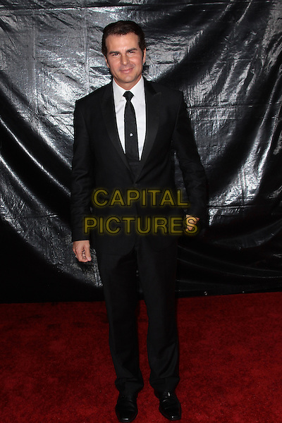 VINCENT DE PAUL.NBC Universal's 67th Annual Golden Globe After Party held at Beverly  Hilton, Beverly Hills, California, USA..January 17th 2010.globes full length black suit .CAP/ADM/TC.©T.Conrad/Admedia/Capital Pictures