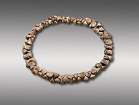 Bone necklace. Catalhoyuk Collections. Museum of Anatolian Civilisations, Ankara. Against a grey background
