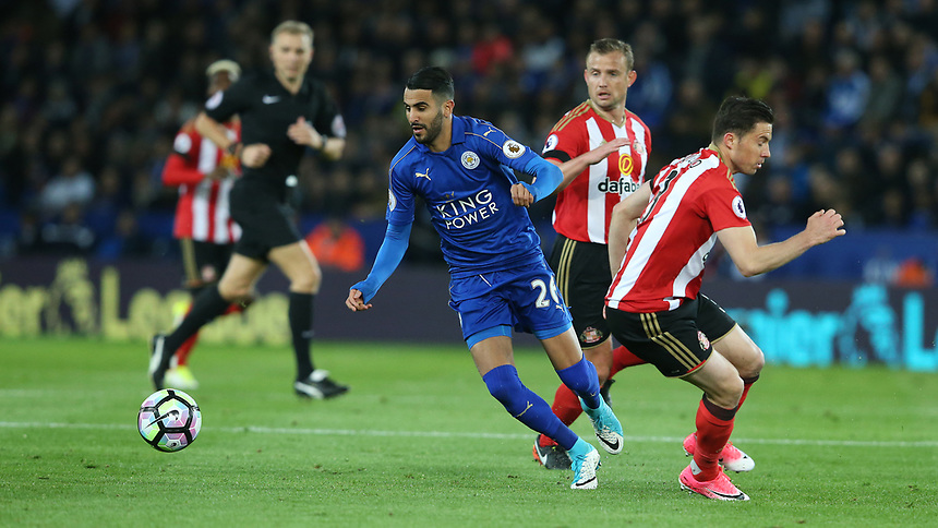 Leicester City's Riyad Mahrez gets away from Sunderland's Bryan Oviedo <br /> <br /> Photographer Stephen White/CameraSport<br /> The Premier League - Leicester City v Sunderland  - Tuesday 4th April 2017 - King Power Stadium - Leicester<br /> <br /> World Copyright &copy; 2017 CameraSport. All rights reserved. 43 Linden Ave. Countesthorpe. Leicester. England. LE8 5PG - Tel: +44 (0) 116 277 4147 - admin@camerasport.com - www.camerasport.com
