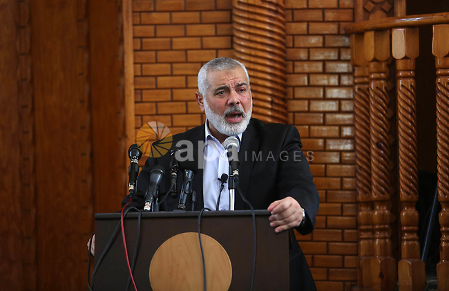 Chairman of the political bureau of the Hamas Palestinian Islamist movement, Ismail Haniyeh speaks during the funeral of Palestinian teenagers Louay Kahil and Amir Al-Namara, who were killed in an Israeli air strike at a mosque during their funeral in Gaza City on July 15, 2018. Photo by Ashraf Amra