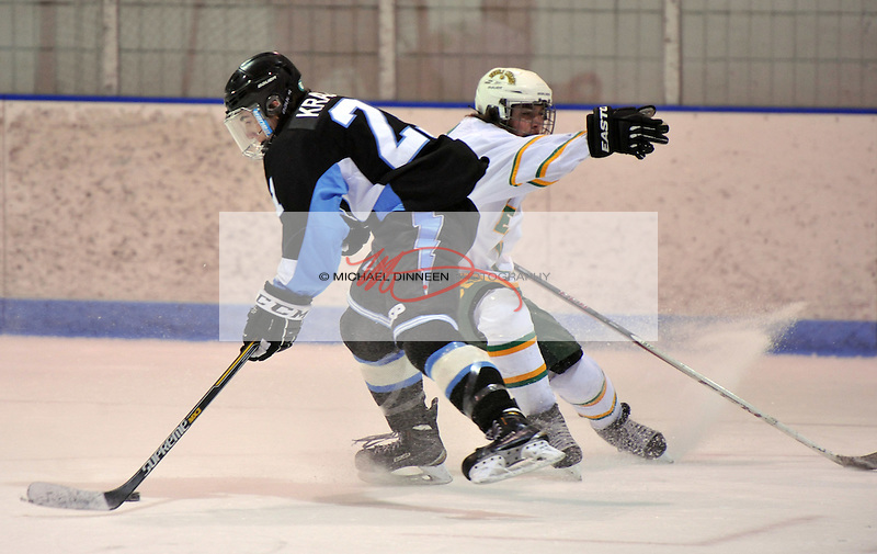 Chugiak's Zachary Krajnik spins away from the defense of Service's Elias Colberg during the first period of Thursday's game.  Photo for the Star by Michael Dinneen