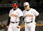 Maryland head coach John Szefc (14) talks with Rob Vaughn (2) during the eighth inning of a Big 10 tournament baseball game against Michigan State in Minneapolis, Wednesday, May 20, 2015. Maryland defeated Michigan State 2-1. (Photo/Ann Heisenfelt)