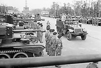 """Prime Minister Winston Churchill, accompanied by Field Marshal Sir Bernard Montgomery and Field Marshal Sir Alan Brooke, inspects tanks of the """"Desert Rats"""" from a half-track vehicle which moved slowly along the long line of troops and armour, during the British Victory parade in Berlin, 21 July 1945."""