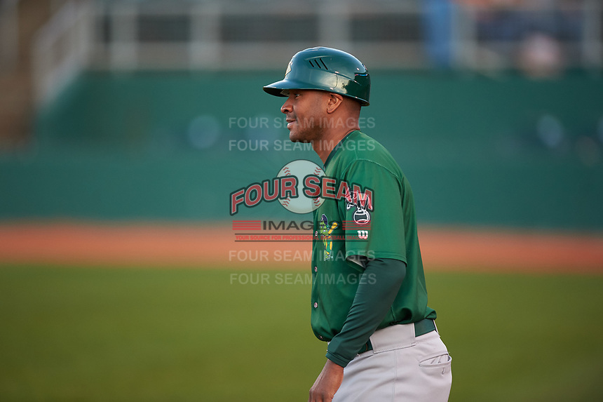 Beloit Snappers manager Lloyd Turner (11) coaches third base during a Midwest League game against the Lansing Lugnuts at Cooley Law School Stadium on May 4, 2019 in Lansing, Michigan. Beloit defeated Lansing 2-1. (Zachary Lucy/Four Seam Images)