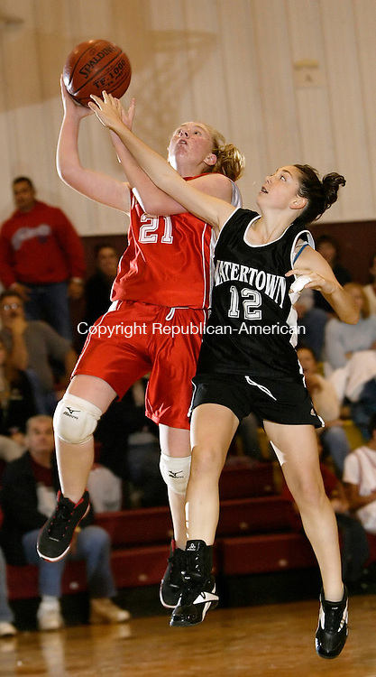 WATERBURY, CT, 11/23/08- 112308BZ07- Wolcott's Katie Harpin (21) goes to the hoop against Watertown's Gabby Rinaldi (12) during the St. Mary's School Tip-off Tournament at the Sacred Heart High School gym Waterbury Sunday night.<br /> Jamison C. Bazinet Republican-American