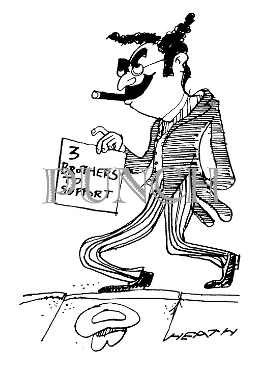 (A Groucho Marx lookalike beggar holds a sign reading '3 Brothers To Support')