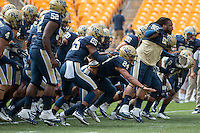 Pitt takes the field for the opening day. Shown are Shakir Soto (52), Pat Amara (25), James Conner (24) and Khaynin Mosley-Smith (95). The Pitt Panthers football team defeated the Youngstown State Penguins 45-37 on Saturday, September 5, 2015 at Heinz Field, Pittsburgh, Pennsylvania.