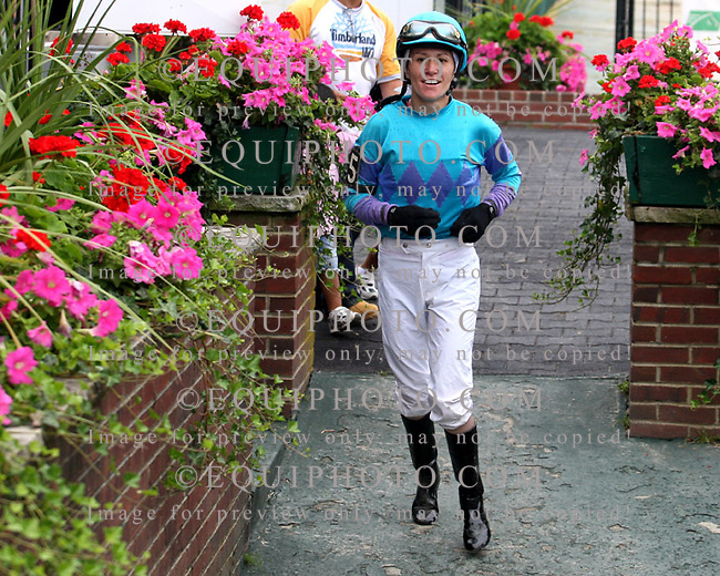 Jockey Monica Garcia scores her first career victory aboard Global Asset in the 1st Race at Monmouth Park in Oceanport, New Jersey on Friday July 12, 2013.  Photo By Bill Denver/EQUI-PHOTO.