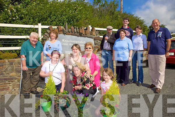 PRIDE: Knocknagoshel residents preparing their village for judging in the national Pride of Place competition this week, front l-r: Sarah Delaney, Rose Delaney, Noreen O'Regan, Patricia Kirby, Catriona Somers. Back l-r: Dan Collins, Kathleen Cremins, Patrick Downey, Brigid Scanlan, Kieran McAuliffe, Helena O'Mahony, Bill Morrell.