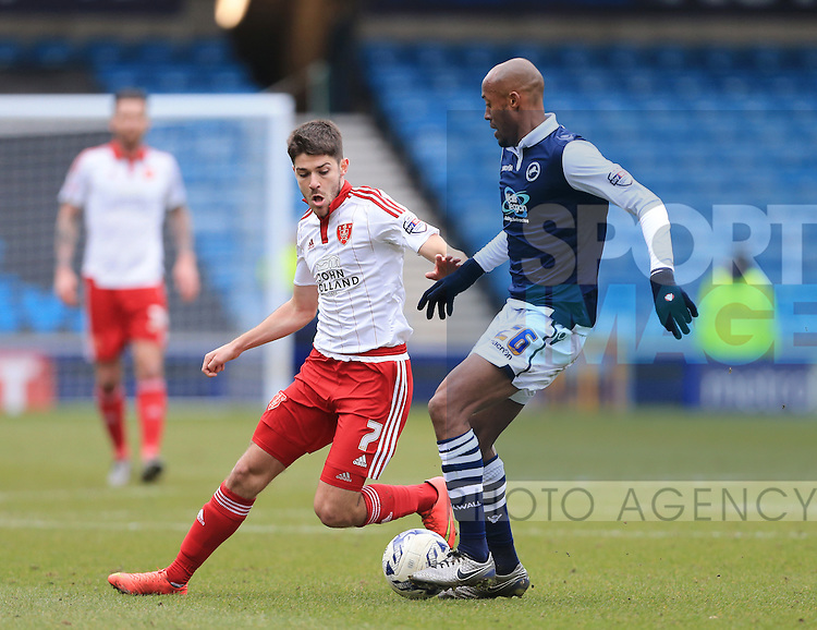 Millwall's Jimmy Abdou tussles with Sheffield United's Ryan Flynn during the League One match at The Den.  Photo credit should read: David Klein/Sportimage