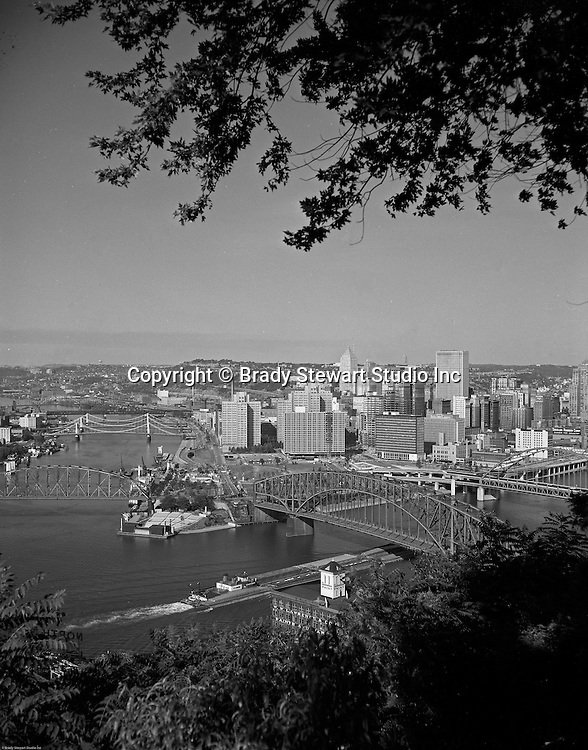 Pittsburgh PA:  View of the City of Pittsburgh from Mt Washington - 1959.  View of the Pittsburgh Hilton and Fort Pitt Bridge construction