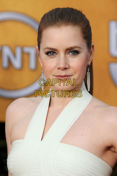 AMY ADAMS.17th Annual Screen Actors Guild Awards held at The Shrine Auditorium, Los Angeles, California, USA..January 30th, 2011.SAG headshot portrait white cream halterneck earrings .CAP/ADM/BP.©Byron Purvis/AdMedia/Capital Pictures.