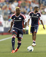 New England Revolution substitute forward Dimitry Imbongo (92) looks to pass. In a Major League Soccer (MLS) match, the New England Revolution (dark blue) defeated Philadelphia Union (light blue), 5-1, at Gillette Stadium on August 25, 2013.