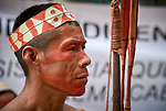 His face painted red with urucum, a man participates in a march by indigenous people through the streets of Atalaia do Norte in Brazil's Amazon region on March 27, 2019. They were protesting a central government plan to turn control of health care over to municipalities, in effect destroying a federal program of indigenous health care. Indian rights activists are worried that the government of President Jair Bolsonaro is reducing or eliminating protections for the country's indigenous people.