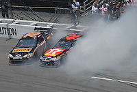 May 6, 2007; Richmond, VA, USA; Nascar Nextel Cup Series drivers Juan Pablo Montoya (42) and Johnny Sauter (70) spin during the Jim Stewart 400 at Richmond International Raceway. Mandatory Credit: Mark J. Rebilas