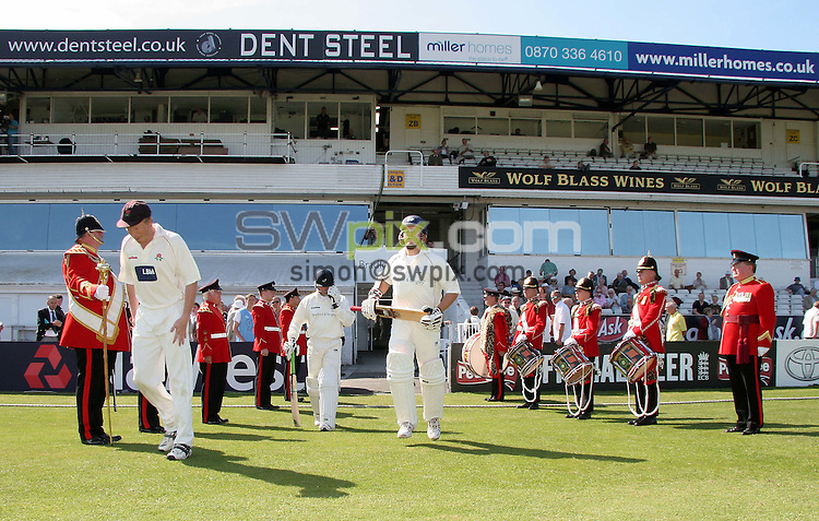 PICTURE BY VAUGHN RIDLEY/SWPIX.COM - Cricket - LV County Championship - Yorkshire v Lancashire, Day 1 - Headingley, Leeds, England - 09/08/07...Copyright - Simon Wilkinson - 07811267706..Yorkshire's Joe Sayers and Craig White are flanked by an honour guard from the Yorkshire Volunteer Band.