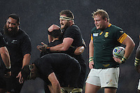 Kieran Read of New Zealand celebrates with Aaron Smith of New Zealand after winning the Semi Final of the Rugby World Cup 2015 between South Africa and New Zealand - 24/10/2015 - Twickenham Stadium, London<br /> Mandatory Credit: Rob Munro/Stewart Communications