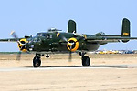 A North American B-25 Mitchell taxies prior to flight during the 2008 Warbirds in Action Airshow at Minter Field near Shafter, California. Serial #44-30801 was first delivered to the USAAF in 1944 and later flew as a sprayer in Wyoming before landing the role of Vestal Virgin in the movie version of the Joseph Heller novel 'Catch 22.' Photographed 03/08