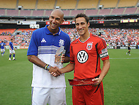 Everton goalkeeper Tim Howard and DC Untied Josh Wolff during a presentation before the game.   Everton defeated DC United 3-1 in a international friendly ,at RFK Stadium, Saturday July 23, 2011.