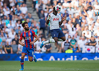 Serge Aurier of Tottenham Hotspur heads the ball clear ahead of Andros Townsend of Crystal Palace during the Premier League match between Tottenham Hotspur and Crystal Palace at Wembley Stadium, London, England on 14 September 2019. Photo by Vince  Mignott / PRiME Media Images.