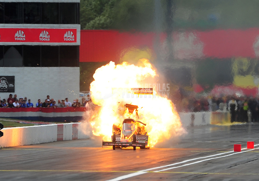 Sept. 5, 2011; Claremont, IN, USA: NHRA top fuel dragster driver Terry McMillen explodes an engine in a ball of fire during the US Nationals at Lucas Oil Raceway. Mandatory Credit: Mark J. Rebilas-