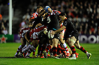 Mariano Galarza of Gloucester Rugby loses his scrum cap as Sam Hidalgo-Clyne of Edinburgh Rugby sends up a box kick