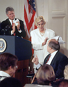 "United States President Bill Clinton, left, and Sarah Brady, center, applaud as former White House press secretary James S. Brady, right, flashes a ""thumbs-up"" during the ""Brady Bill"" signing ceremony in the East Room of the White House in Washington, D.C. on November 30, 1993.  Brady passed away on Monday, August 4, 2014.<br /> Credit: Ron Sachs / CNP"