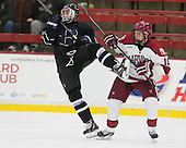 Alex Grieve (Bentley - 23), Kyle Criscuolo (Harvard - 11) - The Harvard University Crimson defeated the visiting Bentley University Falcons 3-0 on Saturday, October 26, 2013, in Harvard's season opener at Bright-Landry Hockey Center in Cambridge, Massachusetts.