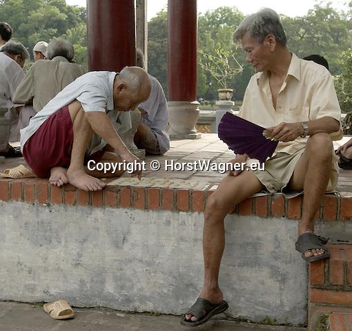 Hanoi-Vietnam, Ha Noi - Viet Nam - 21 July 2005---Men playing a board game at Ngoc Son (Jade Mountain) Temple on Hoan Kiem Lake---culture, people---Photo: © HorstWagner.eu
