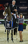 Roger Yves Bost riding Record d'Oreal during the Prize Ceremony after winning the Massimo Dutti Trophy as part of the Longines Masters of Hong Kong on 21 February 2016 at the Asia World Expo in Hong Kong, China. Photo by Juan Manuel Serrano / Power Sport Images