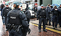 Anti G8 protester is asked to remove her mask by Police during a rally taking place in Belfast City centre ahead of the G8 world leaders summit.Belfast ahead of this weeks G8 Summit in Fermanagh, Northern Ireland, Saturday, June 15, 2013. Leaders from Canada, France, Germany, Italy, Japan, Russia, USA and UK are meeting at Lough Erne in Northern Ireland for the G8 Summit 17-18 June.