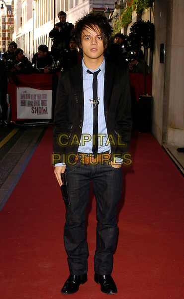 JAMIE CULLUM.The South Bank Show Awards, Savoy Hotel, London, UK..January 23rd, 2007.full length jeans denim black jacket tie scorpion clip.CAP/CAN.©Can Nguyen/Capital Pictures