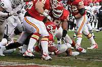 Chiefs running back Larry Johnson backs his way into the end zone for the winning touchdown in the fourth quarter against the Oakland Raiders at Arrowhead Stadium in Kansas City, Missouri on November 19, 2006. The Chiefs won 17-13.
