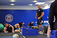 Strength and Conditioning Coach Matt Pickard looks on in the gym. Bath Rugby pre-season training on July 16, 2013 at Farleigh House in Bath, England. Photo by: Patrick Khachfe/Onside Images