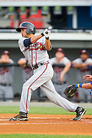 Jose Peraza (4) of the Danville Braves follows through on his swing against the Burlington Royals at Burlington Athletic Park on July 18, 2012 in Burlington, North Carolina.  The Royals defeated the Braves 4-3 in 11 innings.  (Brian Westerholt/Four Seam Images)