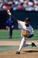 SAN FRANCISCO, CA - John Burkett of the San Francisco Giants pitches during a game against the New York Mets at Candlestick Park in San Francisco, California on April 24, 1994. Photo by Brad Mangin