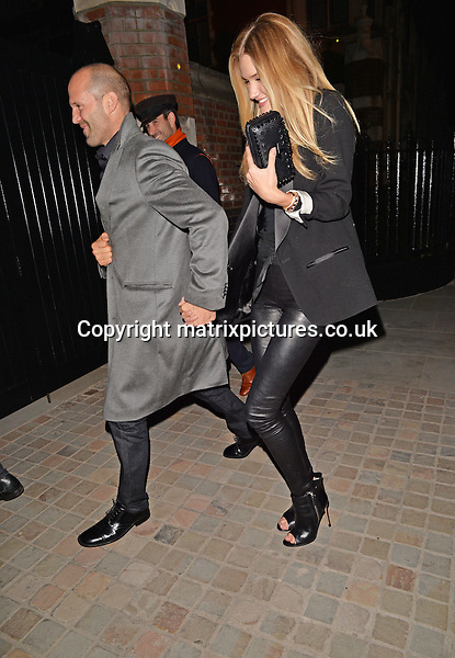 NON EXCLUSIVE PICTURE: PALACE LEE / MATRIXPICTURES.CO.UK<br /> PLEASE CREDIT ALL USES<br /> <br /> WORLD RIGHTS<br /> <br /> English supermodel Rosie Huntington-Whiteley and boyfriend, English actor Jason Statham, are pictured as they go to dinner at Nobu in Central London, England.<br /> <br /> The famed couple were seen sharing a passionate kiss in the back of a cab as they left the restaurant.<br /> <br /> APRIL 26th 2014<br /> <br /> REF: LTN 142058