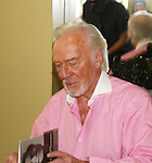 """Christopher Plummer as """"Propero"""" in The Tempest on August 21, 2010. Christopher is signing his new book - his memoirs In Spite of Myself"""". Timothy Stickney is also in Stratford's Shakespeare Festival in The Tempest as """"Sebastian"""" and also in Two Gentlemen of Verona as """"Thurio"""". The Tempest runs June 11 through September 12, 2010. (Photo by Sue Coflin/Max Photos)"""