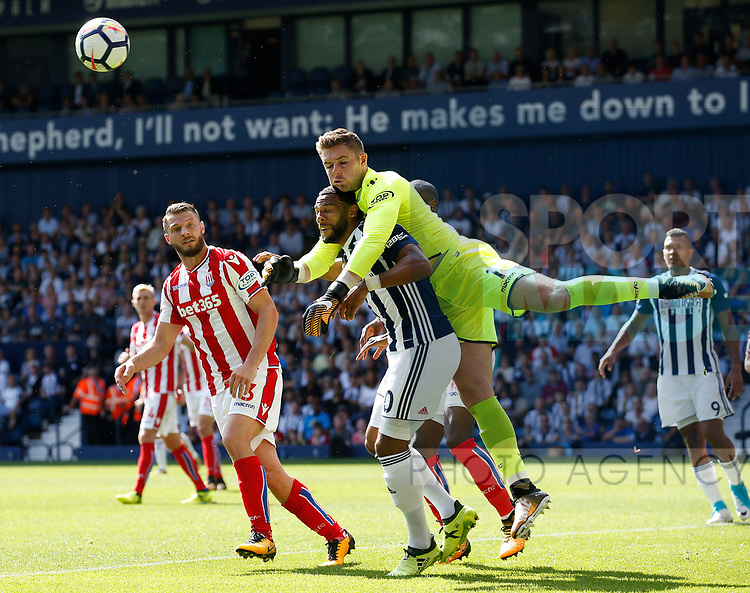 Jack Butland of Stoke City clash into Jose Salomon Rondon of West Bromwich Albion to punch clear during the premier league match at the Hawthorn's Stadium, West Bromwich. Picture date 27th August 2017. Picture credit should read: Simon Bellis/Sportimage