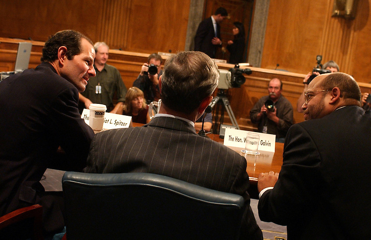 At left, Eliot Spitzer, New York State Attorney General, speaks to William Galvin, Secretary of the Commonwealth of Massachusetts, center, and Paul Roye of The US Securities and Exchange Commission, before a hearing of the Senate Governmental Affairs Subcommitte on Financial Management, the Budget and International Security.  Sen. Pete Fitzgerald, R-Ill., charied the hearing on abuses being uncovered in the mutual fund industry.