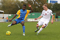 Ayodeji Olukoga of Romford and Sam Beale of Hastings during Romford vs Hastings United, FA Trophy Football at Ship Lane on 8th October 2017