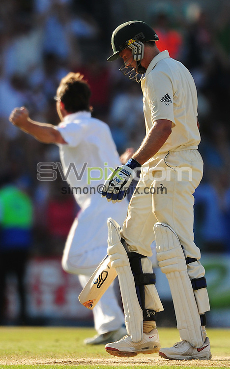 PICTURE BY ALEX BROADWAY/SWPIX.COM - Cricket - The Ashes 2009, 5th Test - England v Australia, Day Four - The Oval, London, England - 23/08/09...Copyright - Simon Wilkinson - 07811267706...Australia's Michael Hussey leaves the pitch dejected as Graham Swann of England celebrates behind him.