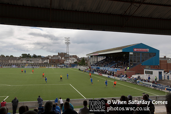 Queen of the South 2 Stranraer 0, 11/08/2015. Scottish Challenge Cup first round, Palmerston Park. Home supporters in the Portland Drive terrace end during the first-half at Palmerston Park, Dumfries, as Queen of the South (in blue) host Stranraer in a Scottish Challenge Cup first round match. The game was the opening match of the season in a competition open to sides below the Scottish Premiership. Queen of the South won the match 2-0, watched by a crowd of 1229 spectators. Photo by Colin McPherson.