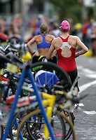 08 MAY 2004 - FUNCHAL, MADEIRA - Competitors run through transition after finishing the swim during the World Age Group Triathlon Championships. (PHOTO (C) NIGEL FARROW)