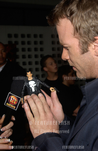 Actor THOMAS JANE at the Los Angeles premiere of his new movie The Punisher...He's holding a Punisher action figure, which is the character he plays in the movie..April 12, 2004