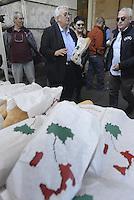 Roma, 14 Maggio 2014<br /> L'eurodeputato della Lega Nord Mario Borghezio visita il rione multietnico di Piazza Vittorio per la campagna elettorale per le Elezioni europee.<br /> Borghezio nei portici di Piazza Vittorio distribuisce pane.<br /> <br /> The euro deputy of the Northern League Mario Borghezio visit the multi ethnic district of Piazza Vittorio to the electoral campaign for the European elections. <br /> Borghezio in the porticoes of Piazza Vittorio distributes bread.